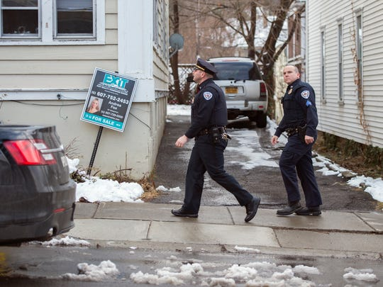 Police investigate the scene of a reported armed home invasion Tuesday afternoon at 1280½ Vestal Ave. in Binghamton.