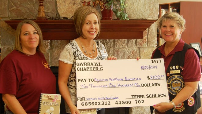 Gold Wing Roads Riders Association local Chapter C representatives Dori Easterson, left, and Jill Krizizke (director) at right, recently made a $2,100 donation to the Agnesian HealthCare Foundation Breast Cancer Fund. Michelle Ries, Agnesian HealthCare Foundation is at center.