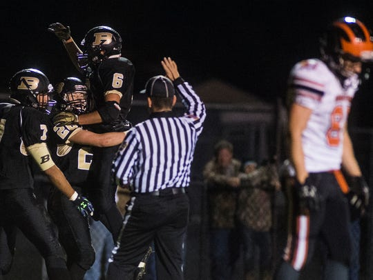 Biglerville's Dayne Showers is congratulated by teammates
