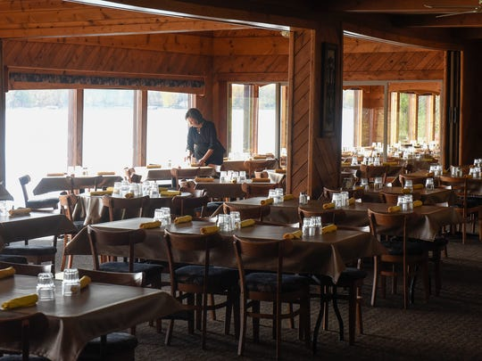Tables with a view of the lake are set Wednesday, Oct.