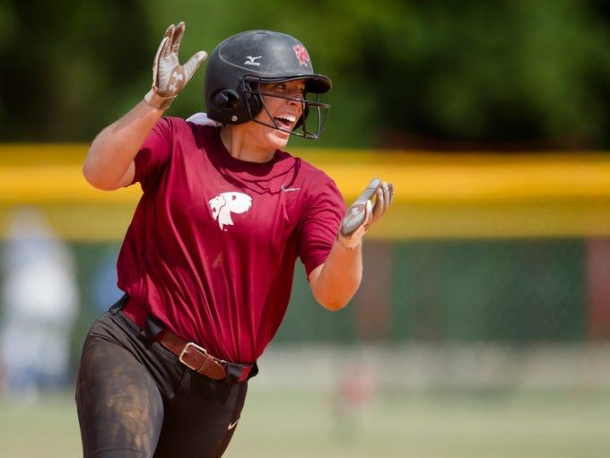 Prattville's Emma Hindi celebrates hitting a 3-run
