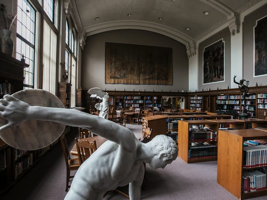 Statues and large murals fill the library of Fordson