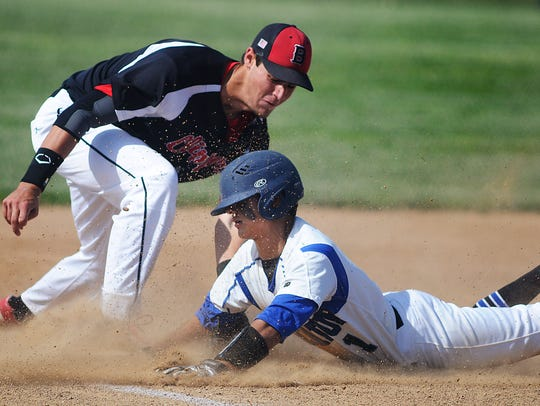 Bennett's Simon Palenchar places a tag on Stephen Decatur's Nick Bennett at third base.