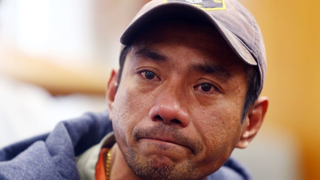 Harry Pangemanan holds back tears as he tells his story of ICE officers knocking on his door this morning. Pangemanan is now claiming sanctuary at the Highland Park Reformed Church as two other Indonesian men were detained today. January 25, 2018. Highland Park, NJ.