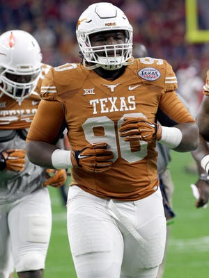 Texas defensive tackle Malcom Brown warms up before the Texas Bowl on Dec. 29, 2014, in Houston.