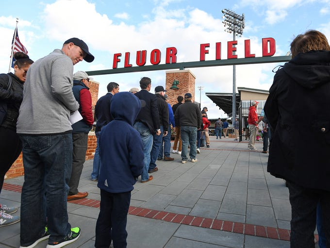 Fans line up to enter Fluor Field for the Greenville