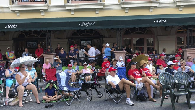 In this file photo, supporters of President Donald Trump wait outside in a town square in The Villages before an appearance by the president. There has always been a low-boil tension in The Villages between the Republican majority and the much smaller cohort of Democrats. Those tensions got international attention last weekend when President Donald Trump tweeted approvingly of a video showing one of his supporters at the retirement community chanting a racist slogan associated with white supremacists.