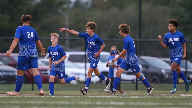Sophomore Grayson Anderson (15) celebrates scoring a goal in the first half against Newton on Thursday, Sept. 17. Andover would win the match 3-1.