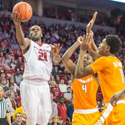 Arkansas guard Manuale Watkins (21) drives to the basket during a game between the Razorbacks and Tennessee Volunteers on Saturday at Walton Arena.
