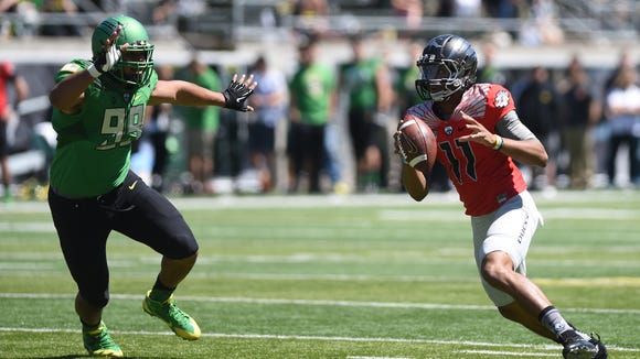 Oregon's Travis Jonsen runs the ball during the Ducks spring game on Saturday, May 2, 2015, at Autzen Stadium in Eugene.