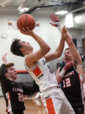Ridgewood's Chase Griffith shoots against defense from Claymont's Brady Milburn and Michael Lesiecki. Griffith earned second-team honors in Division III, as the East District teams were announced.