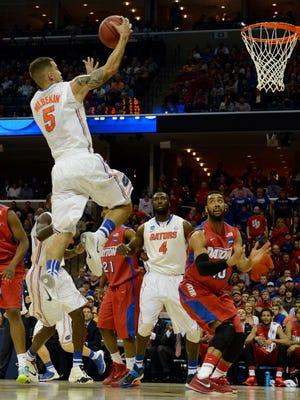 Florida's Scottie Wilbekin soars to the basket.