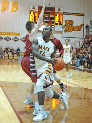 Senior Maverick Darnell Butler drives to the basket in heavy traffic Saturday night as McCutcheon hosted Danville.