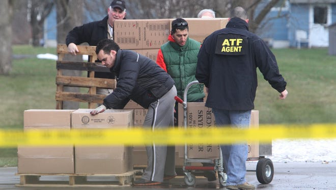 ATF agents seize cigarettes at Sky Dancer Smoke Shop in Seneca Falls, N.Y., in January.