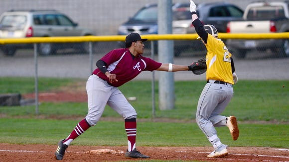 Asheville's Xaviar Stewart tags out Tuscola's Patrick
