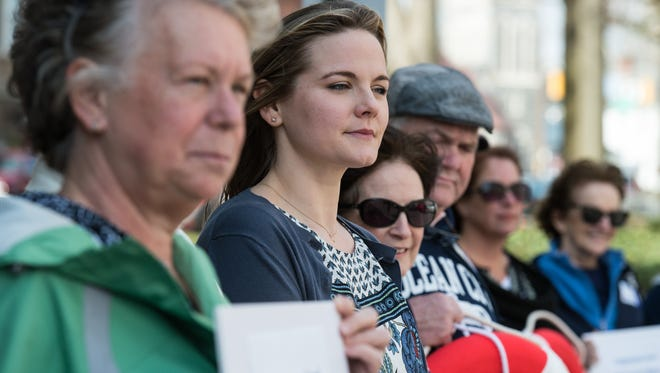 Rally goers stand side by side during an effort to implore U.S. Rep. Andy Harris to maintain coverage for cancer patients under future replacements of the Patient Protection and Affordable Care Act, downtown on Tuesday, March 7, 2017.