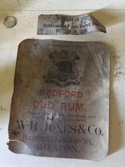A label from a case of Medford Old Rum was among the
