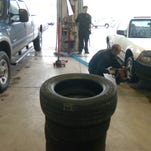 A car gets new snow tires at Discount Tire on South College Avenue in this 2006 photo.