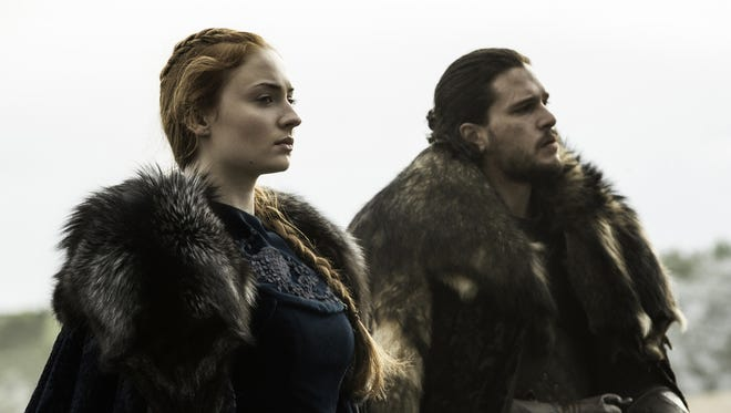 Sophie Turner, left, talked about the relationship between her Sansa Stark and Jon Snow (Kit Harington) at the 'Game of Thrones' Comic-Con panel Friday.