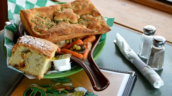 The lamb pot pie from Duffy's Tavern, baked with wild mushrooms, celery, peas, carrots and mashers in a puff pastry, served with a side of Irish soda bread.