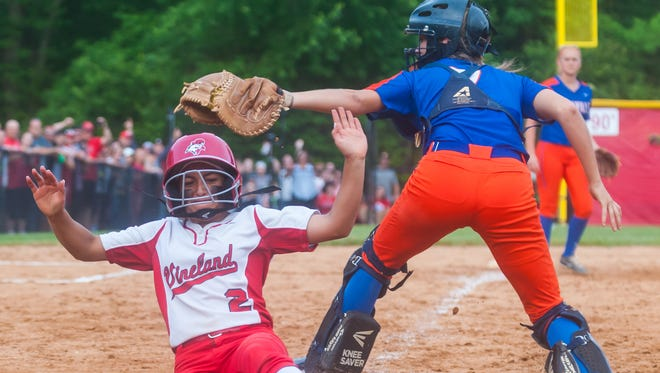 Vineland pinch-runner Ariana Torres beats a throw to the plate to score the game-winning run in Tuesday's South Jersey Group 4 final. The Fighting Clan beat Millville in nine innings, 3-2.
