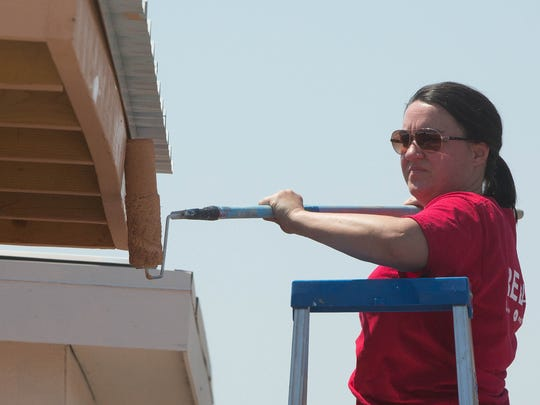 Chasity Rosales, one of the Keller Williams' agents who gathered to paint the tent shelters at Camp Hope, Thursday, June 22, 2017. Keller Williams closes its office once a year and works on community projects like the painting for the tent shelters.