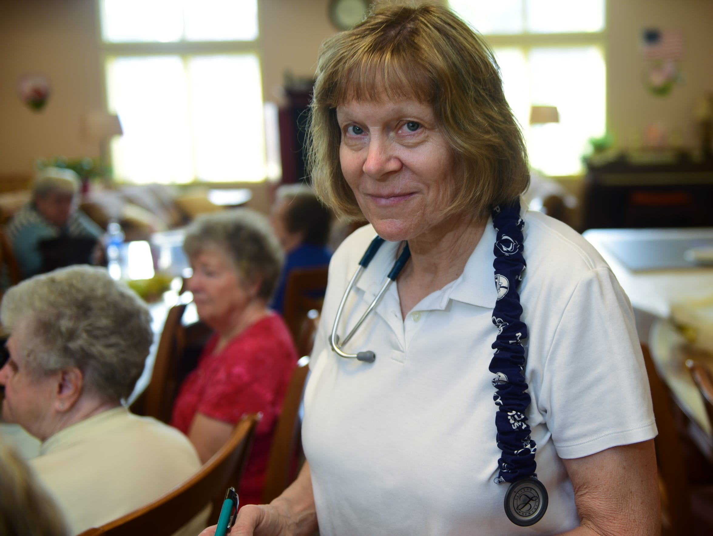 Community nurse Dee Parson visits residents at Episcopal