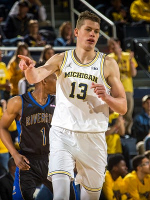 Michigan forward Moritz Wagner (13) points to his bench after making a basket in the first half of an NCAA college basketball game against UC Riverside at Crisler Center in Ann Arbor, Mich., Sunday, Nov. 26, 2017.
