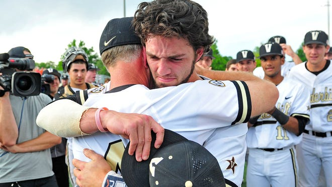 Vanderbilt's Dansby Swanson, right, hugs Coach Tim Corbin after Swanson is  picked No. 1 by the Diamondbacks in the Major League Draft and after the Commodores clinched a spot in the College World Series with a 4-2 win over Illinois.