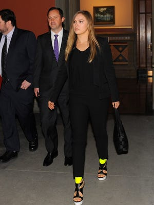 APMixed martial arts women's bantamweight champion Ronda Rousey, walks in the hallway to a meeting with Gov. Andrew Cuomo and state leaders at the state Capitol on Monday. Mixed martial arts women's bantamweight champion Ronda Rousey, walks in the hallway to a meeting with New York Gov. Andrew Cuomo and state leaders urging them to join the 49 other states in legalizing the controversial sport at the state Capitol on Monday, March 23, 2015, in Albany, N.Y.