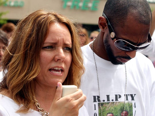 Lisa Sawyer and Terence Garnett address the crowd during a march and rally Saturday in Middletown in support of prosecuting the man whose fight with her son resulted in Ty Sawyer's death.