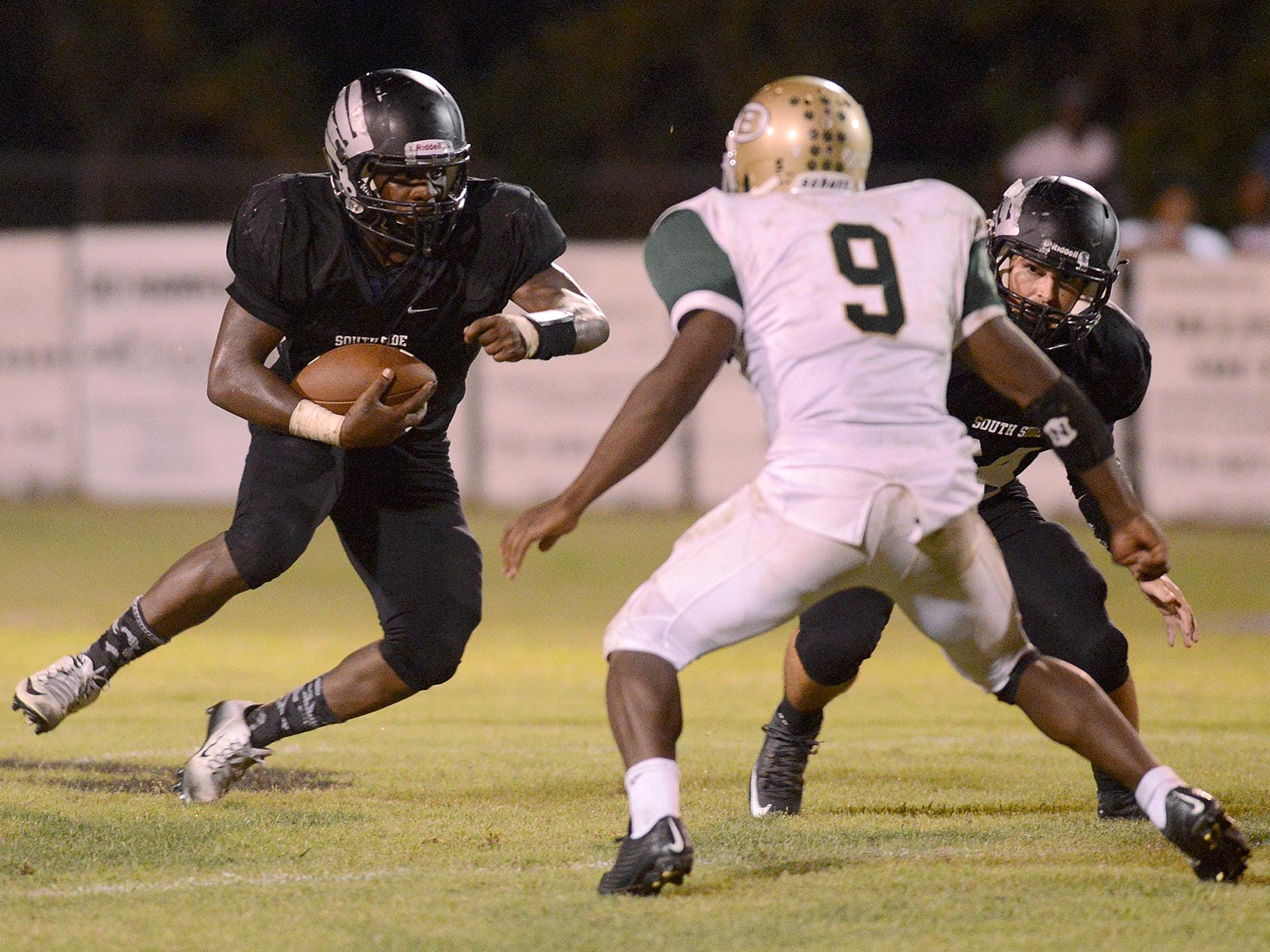 South Side's Tariq Robinson carries the ball against Bolivar at South Side on Friday.