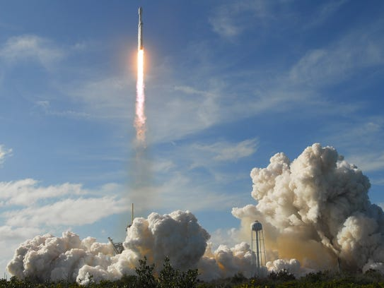Falcon Heavy lifts off from Kennedy Space Center.
