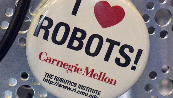 A button on the robotic display belonging to Team RobotiX from Pittsburgh during the First Tech Challenge at Dallastown Area Intermediate School Saturday, Feb. 27, 2016. Randy Flaum photo
