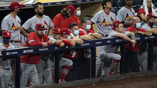Members of the St. Louis Cardinals watch from the dugout during the ninth inning of Game 3 of the team's National League Wild Card series against the San Diego Padres on Friday in San Diego. The Padres won 4-0 and eliminated the Cardinals from the playoffs.