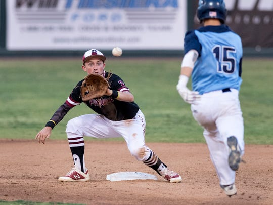 Mt. Whitney's Tyler Hinkley prepares to out Redwood's Davis Beavers at second in a West Yosemite League high school baseball game on Friday, May 11, 2018.