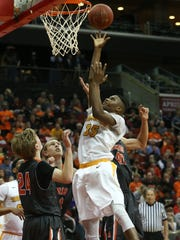Hoover sophomore Douglas Wilson puts up a shot and gets the foul against Ames on Wednesday, March 11, 2015, at Wells Fargo Arena in Des Moines, Iowa.