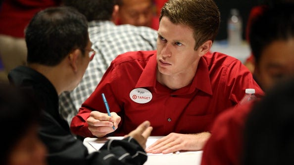 A Target employee interviews a job seeker during a job fair at a new Target retail store on Aug. 15 in San Francisco.
