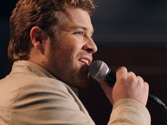 Bart Millard (J. Michael Finley) performs 'I Can Only Imagine' in public for the first time in the movie of the same name.