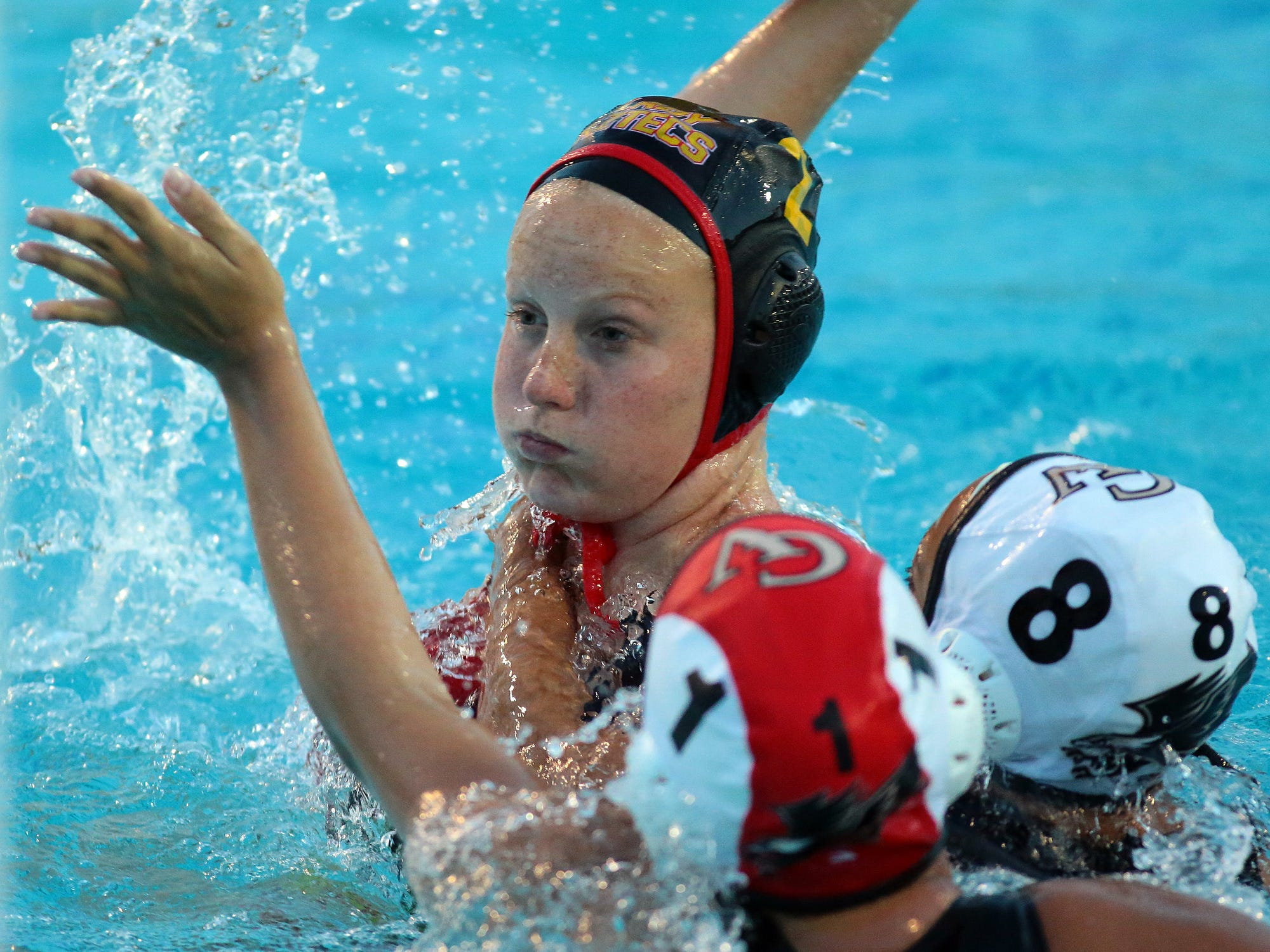 Sarah Nichols of Palm Desert (2) is able to make a shot and score one of her four goals while battling defensive pressure from Citrus Valley during Palm Desert's girls water polo playoff game in Palm Desert on Wednesday, February 18, 2015. Palm Desert won 14-4.