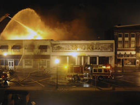 Strong winds threaten to refresh a fire that heavily damaged at least four office buildings in downtown Milton and also damaged the historic Imogene Theatre (far right in photo) in this News Journal file photo from Jan. 6, 2009.