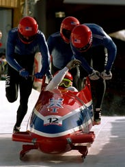 The American four-man bobsled team competes in the