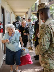 Soldiers from 2nd Battalion, 127th Infantry, 32nd Infantry Brigade Combat Team assisted Pembroke Pines Police Department with distribution health and wellness checks for people in need as a result of Hurricane Irma.
