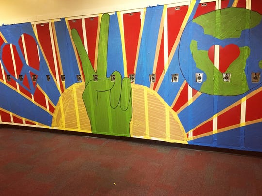 A masking tape mural was created at Highland Park Middle School as part of the annual Diversity Day conducted at the school on May 4.