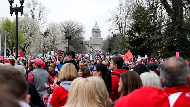 Protesters march up Capital Avenue to the Statehouse in Frankfort, Ky.