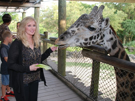 Celebrity guest Morgan Fairchild makes a friend during the Safari Under the Stars fundraiser to benefit the zoo's wildlife conservation and education on April 25, 2015, at Brevard Zoo.