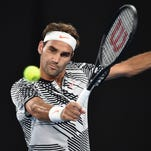 Roger Federer returns with a win, joins Andy Murray in second round