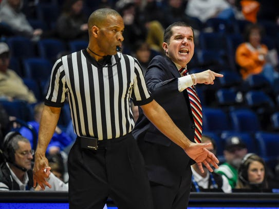 Ole Miss coach Matt Insell cheers on his team in the first half against Florida on Wednesday.