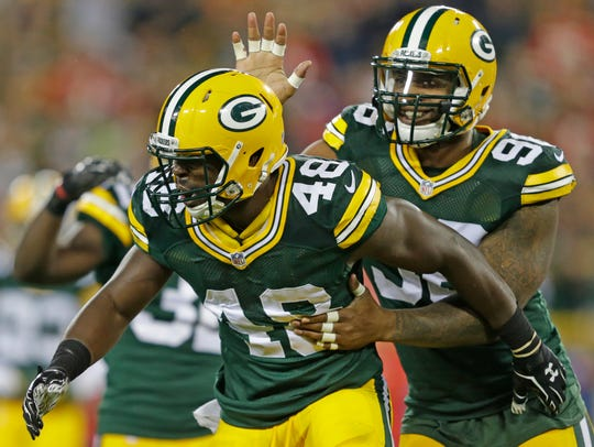 Packers linebacker Joe Thomas (48) celebrates an open