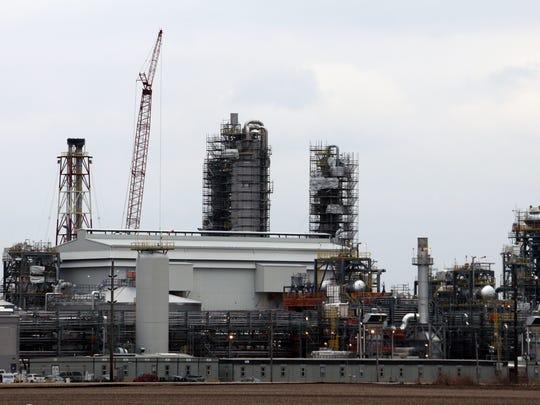 The $2 billion Iowa Fertilizer Co. plant rises from
